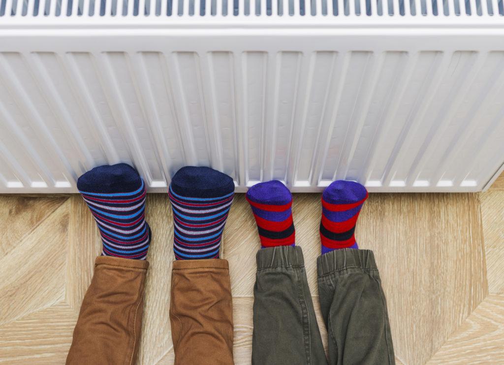 Warming feet on a radiator
